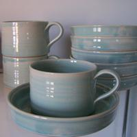 Stoneware; French breakfast cups (10 cm. diam.) and saucers/plates; stackable and great for a warm croissant;