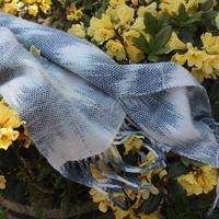 Handwoven woollen scarf with hand-dyed 'faux-ikat' resist dyed warp