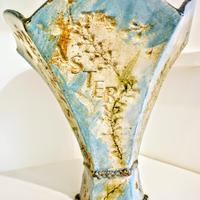 A High Fired stoneware Slab vase, with impressed flowers,  decorated with underglazes and engobes.
