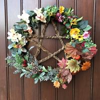 Pentacle wreath featuring spring, summer, autumn and winter flowers