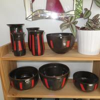Black and red vases and bowls. £20-40.
