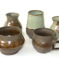 Selection of many diverse vases, plant pots and mugs in black clay. £10-25.