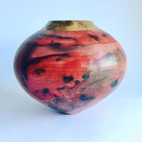 Red smoke-fired pot with gold lustre. Height 13cm width 15cm.