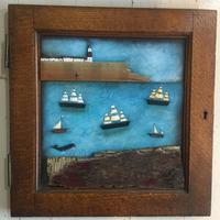 Coastal scene set in an old cupboard door