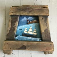 Coastal scene set in a driftwood frame