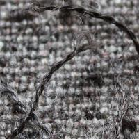 'Pigtail' handspun yarn minic hairs on cushion fabric woven from Wensleydale and silk.