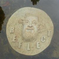 Bas-relief cement cast portrait of Ai Weiwei, displayed under water