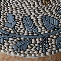 Close up of Lancashire Heeler border detail of Hand carved Honister slate leaves and fruits.
