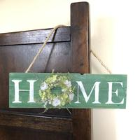Wooden hanging sign saying home