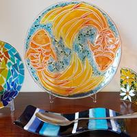 Multi-coloured bowl, fish bowl, daisy wave and spoon rest.