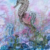 Etched seahorse print with hand embroidery on procion dyed cloth.
