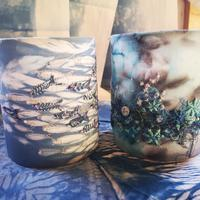 Shibori indigo and hand dyed fabric lanterns with free motion and hand embroidery.
