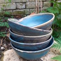 Nesting set of soup bowls with dark turqoise mottled glaze.