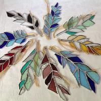 Colourful hanging glass feathers