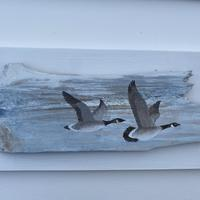 Two flying Geese by shore. Acrylic on fence fragment
