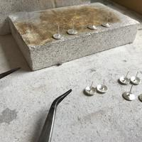 Some earrings in the making. One of the finished pairs are on the photo showing examples of my work