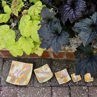 White porcelain stoneware clay stained orange/brown/lemon.