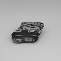 Onyx and Aneto Porcelain brooch with silver wire.
