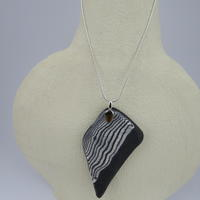Onyx and Aneto Porcelain pendant with silver snake chain