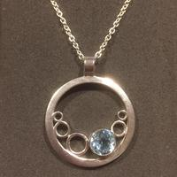 Silver bubbles pendant with sky blue topaz