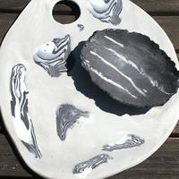 Black and white porcelain cheese board and small dish.