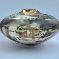 Large smoke-fired vessel with gold lustre. Height 16cm width 26cm.