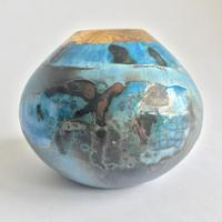 Blue smoke-fired pot with gold. Height 7cm width 8.5cm.