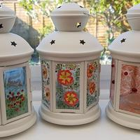 Fused glass lanterns using powder, frit, paint and beads.