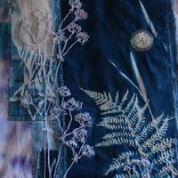 Cyanotype print with free motion and hand embroidery.