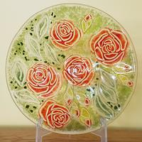 Fused glass bowl featuring roses using the powder technique.