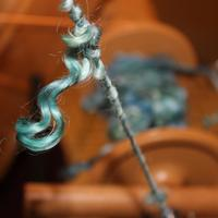 Lockspun yarn allows the individual locks to hang free. These are hand-dyed Teeswater, soft and shiny.