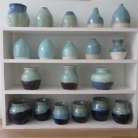 Small vases in blues and turquoises. £10-20.