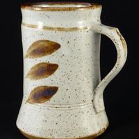 Reduction fired 1 pint tankard white glaze with iron oxide brushwork