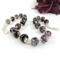 Serendipity lampwork glass bead and sterling silver necklace