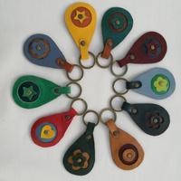 A selection of fun coloured leather key rings, individually hand crafted by 2MaddBags from up-cycled leather