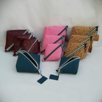 Leather or Cork diamond shaped pouches in three different sizes.  Hugely useful for many things that need a tidy up including:  Computer Mouse, Phone or Computer Cord tidy, Card & Money Pouch, Jewellery & Watch travel pouch, Crafters companion, Stationery holder.