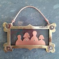 Recycled copper 'family' framed with a repurposed brass drawer name frame