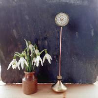 Repurposed clock parts flower head with a brass door knob base
