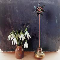 Recycled copper flower in a repurposed brass door knob base