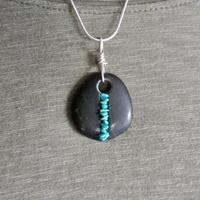 Turquoise wrapped pebble pendant necklace; sterling silver, turquoise.