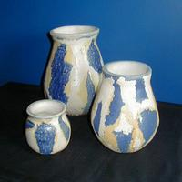 Coiled pots with surface texture like peeling paintwork