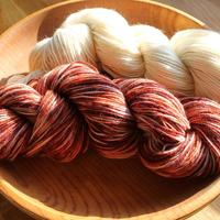 Skeins showing before and after dyeing