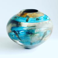 Smoke-fired vessel with blue glaze expressive brush strokes and gold lustre.        strokes