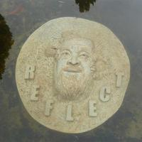 Underwater cement cast of high relief portrait of Ai Weiwei