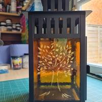 I love making the glass for lanterns and this is my largest and most recent.  I cut a stencil and then used gold coloured mica to create this tree of life image.