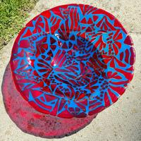 This red and turquoise bowl really zings in the sunlight and throws lovely reflections.