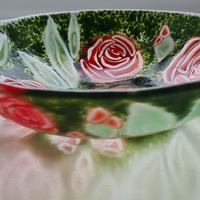 Roses are one of my favourite flowers and  I was inspired create this bowl after seeing the ones in my garden.   It looks amazing with either red or yellow flowers.  They are complemented by the surrounding dark green foliage making the bright colours shine out.