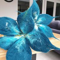 Handfelted flowers in rich teal. Flowers can be made to order in any colour £28 each.