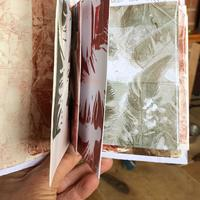Envelope book printed with feathers