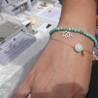 A customer at Art in the Park with their purchases - larimer and amazonite bracelets with gold vermeil charms